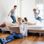 Working From Home With Kids Jumping On The Bed